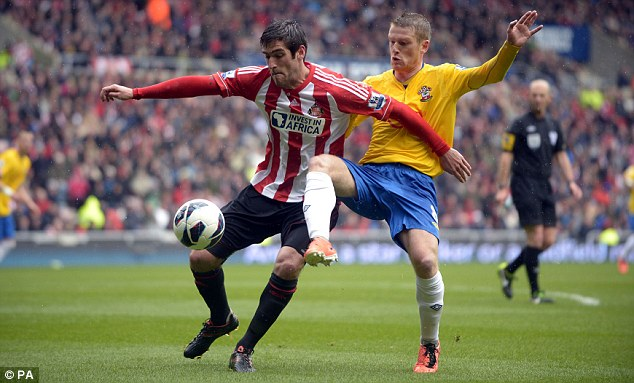 Fighting a losing battle: Graham (left) has struggled at Sunderland since his £5m January move