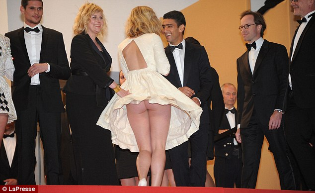 Too much: A guest's skirt blew up to reveal her derriere at the premiere of La Vie D'Adele in Cannes on Thursday