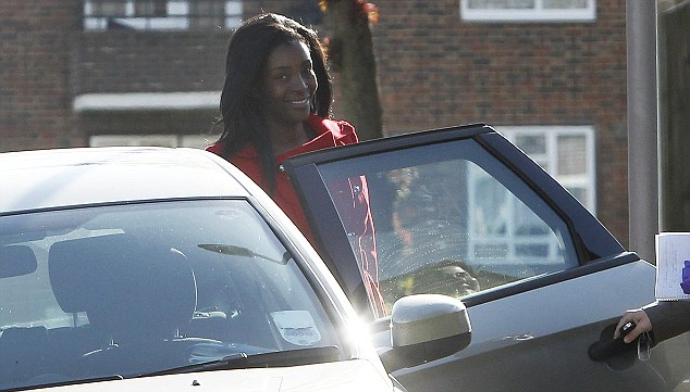 Led away: Blessing Adebolajo gets into the vehicle yesterday and was taken away. She has not been arrested