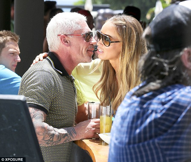 Getting to know you: Lauren Pope was seen giving Wayne a very friendly welcome at the bar