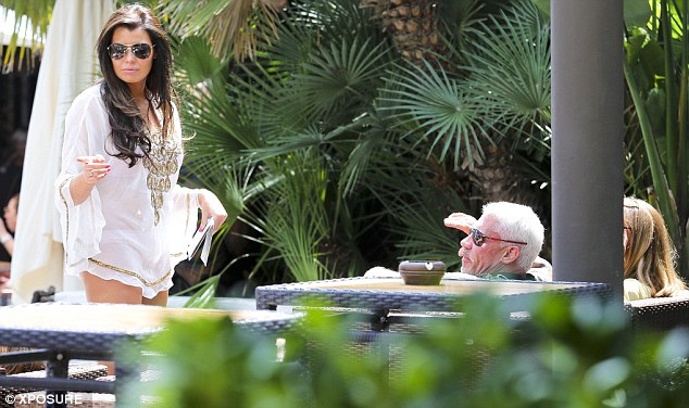 Covered up: Jessica wore a white kaftan with gold embellishment on it as she chatted to Wayne and Lauren