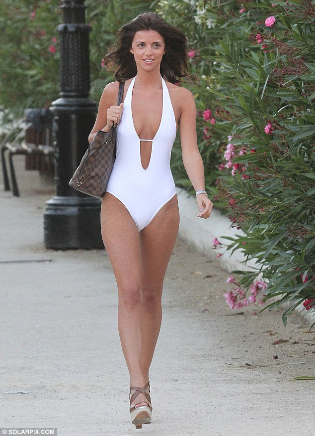 Wow factor: Lucy Mecklenburgh drew attention in a stunning swimsuit that showcased her impressive figure
