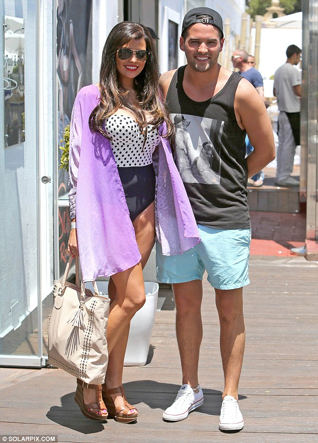 Sunny smiles: Jessica Wright and Ricky Rayment looked ready to party in Marbella