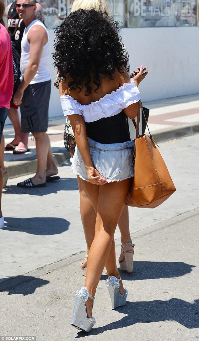 Just adjusting: The actress appeared to find it difficult to get her shorts 'just right' as she made her way to a party
