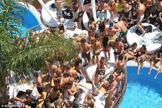 Birds eye view: Party guests gathered around the pool at Sisu in Marbella to soak up the sun and enjoy the music