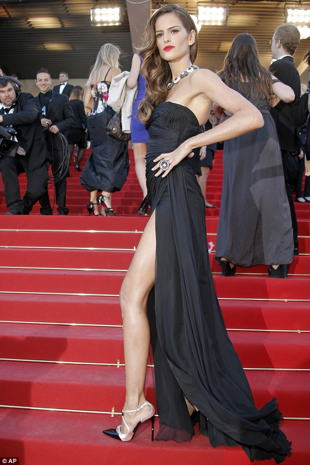 Va va voom! The Brazilian model made sure her best assets were on display as she made her way up the stairs to the Palais Des Festivals