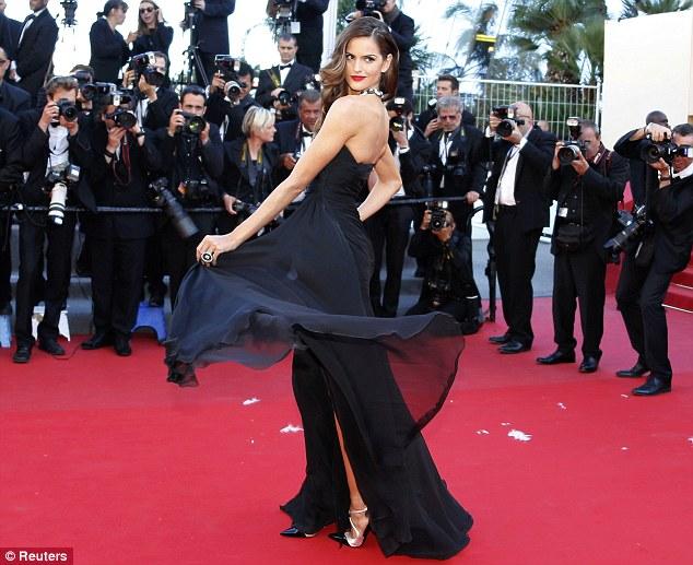 Spinning around: Izabel's designer dress featured a chiffon top layer