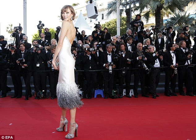 All eyes on her: Karlie poses up a storm for the world's press