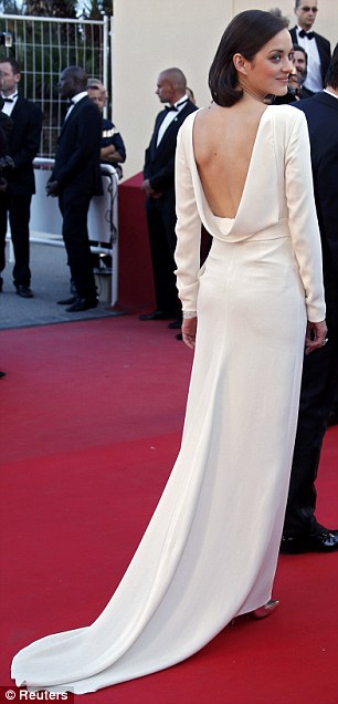 All white now: Marion Cotillard wore a striking white backless dress and silver pumps to the screening
