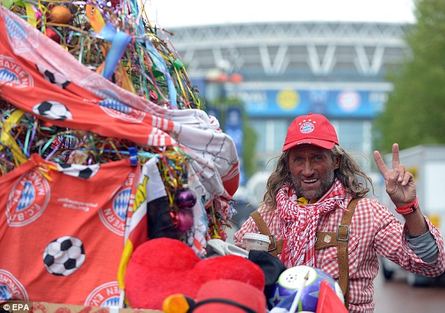 Coming through: Bayern Munich supporter Helmut Robers arrives at Wembley stadium on his bike