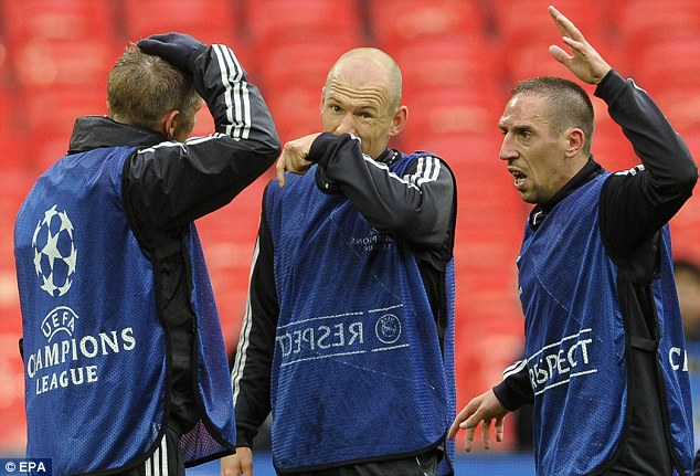 Deep discussion: Bastian Schweinsteiger, Arjen Robben and Franck Ribery at Wembley