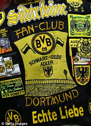 Nice jacket: A Dortmund fan at Wembley showing off his collection of patches