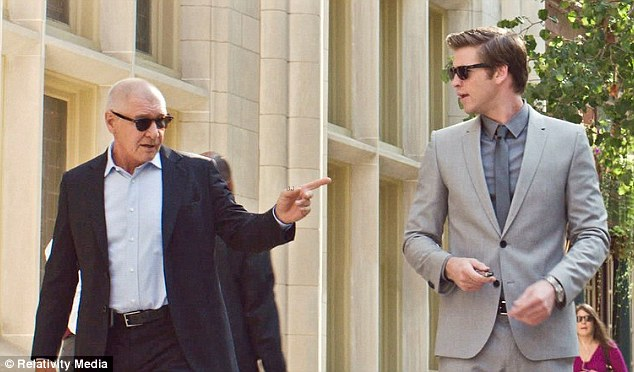 Cool guys: Harrison and Liam show their slick sides by sporting similar shades