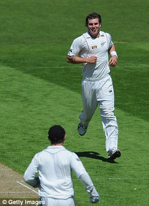 Joy: Bracewell is all smiles after his wicket of Cook