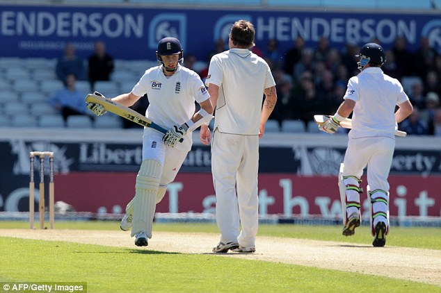 Thirsty work: Joe Root and Ian Bell steadied the ship for England with a 50 partnership