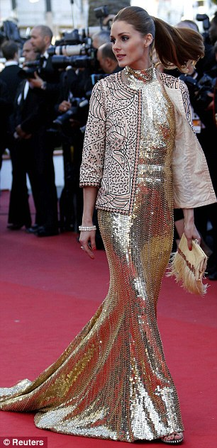 Making an entrance: American fashionista Olivia Palermo in gold (left) and Uma Thurman in black