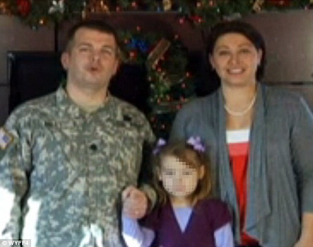 Criticized: Lieutenant Colonel Joseph Miley, pictured with his wife Tracey and child, is accused of creating a 'toxic environment'