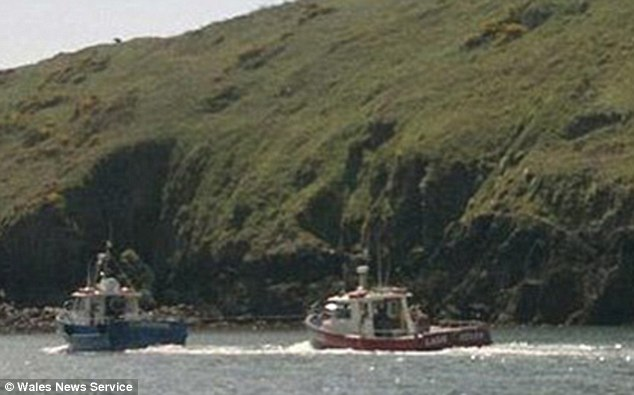 The Lady Helen is assisted by her sister ship The Dale Princess boat  after it struck a rock and took on board water
