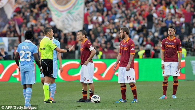 Anger: Roma Francesco Totti argues with the referee during the game