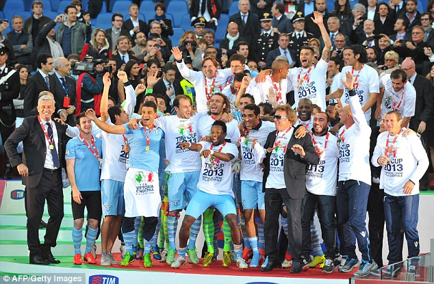 Over the moon: Lazio players celebrate after claiming their sixth Italian Cup title