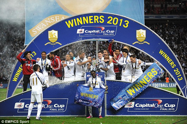 Capital gain: Swansea celebrate with the League Cup