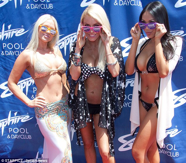Silly shades: Crystal and her fellow bikini babes model the colourful sunglasses created for the event