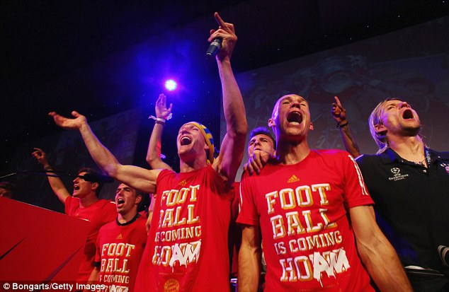 Cheery: Bayern players appear to be belting out a song as Schweinsteiger and Robben lead the way