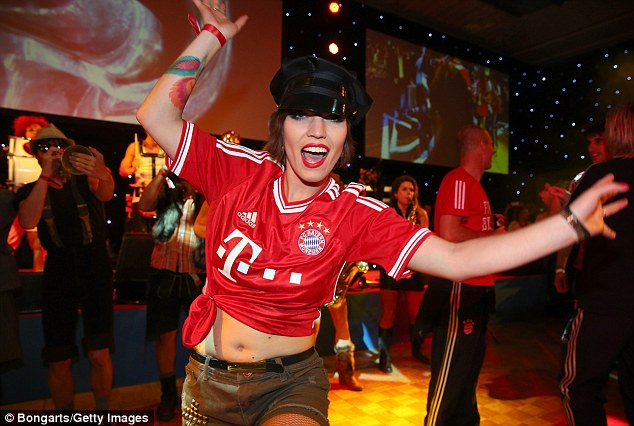 Raucous: A performer dances in a Bayern shirt as the party went on to the early hours