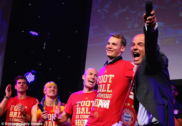 Colossus: A modest-looking Manuel Neuer towers above his team-mates