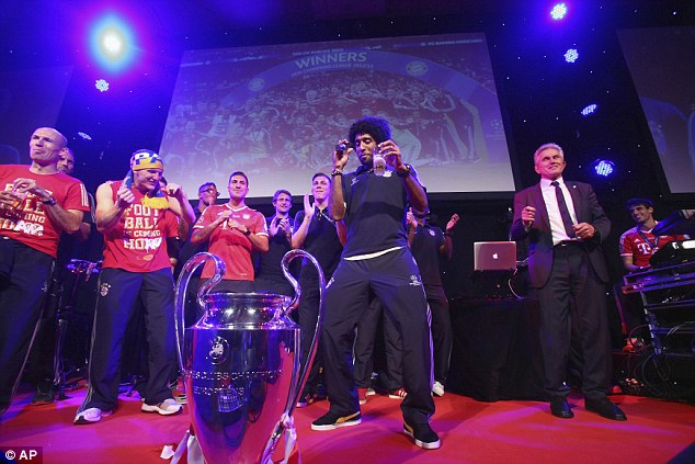 Bust a move: Dante performs a dance on the stage in front of his team-mates