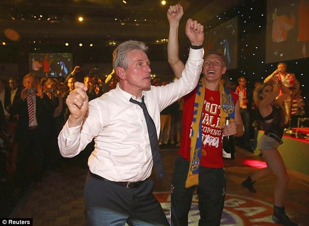 Leading by example: Jupp Heynckes (left) has a dance with midfielder Bastian Schweinsteiger