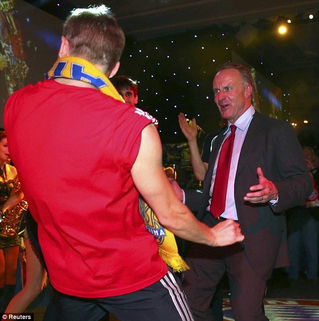 You too: Bayern chief executive Karl-Heinz Rummenigge hits the dance floor too