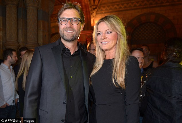 Always smiling: Dortmund manager Jurgen Klopp was at the Natural History Museum with his wife Ulla