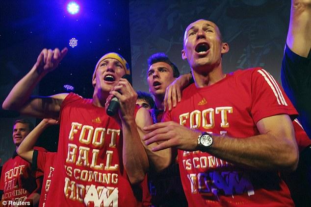 Party time: Arjen Robben (right) and Mario Mandzukic (centre) joined Schweinsteiger