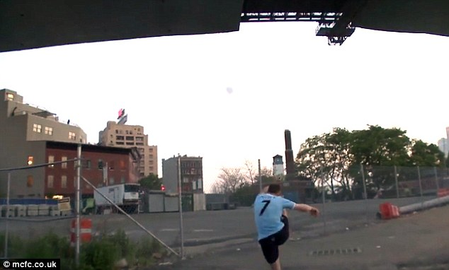 Go for it: Milner swings his boot from below in his bid to reach the Bridge