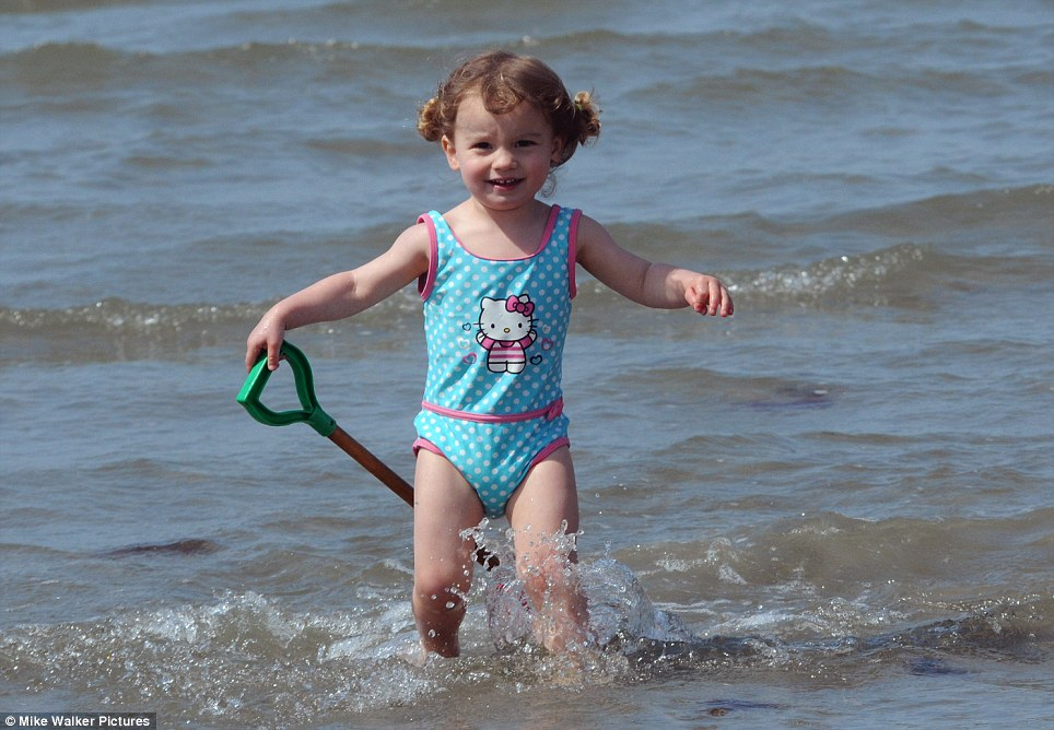 Two year old Isla Vann- Poletti enjoys the warm sunshine at Wittering. Most of England and Wales will enjoy clear skies and sunny spells today but heavy downpours could dampen spirits
