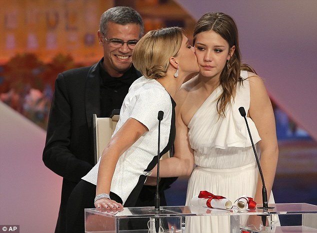 Emotional: Director Abdellatif Kechiche, left, smiles as Adele Exarchopoulos, right, is kissed by Lea Seydoux after they were presented the Palme d'Or award for La Vie D'Adele