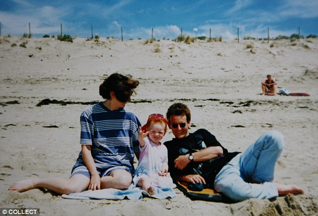 Lindsay and John on holiday with their eldest daughter Ellie. After Lindsay was given five years clear of cancer she felt 'an enormous wave of guilt' at the thought of surviving when Ellie and John hadn't