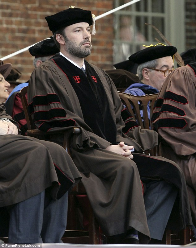 So studious: The 40-year-old was on his best behavior as he waited for his degree among his peers on the Providence, Massachusetts campus