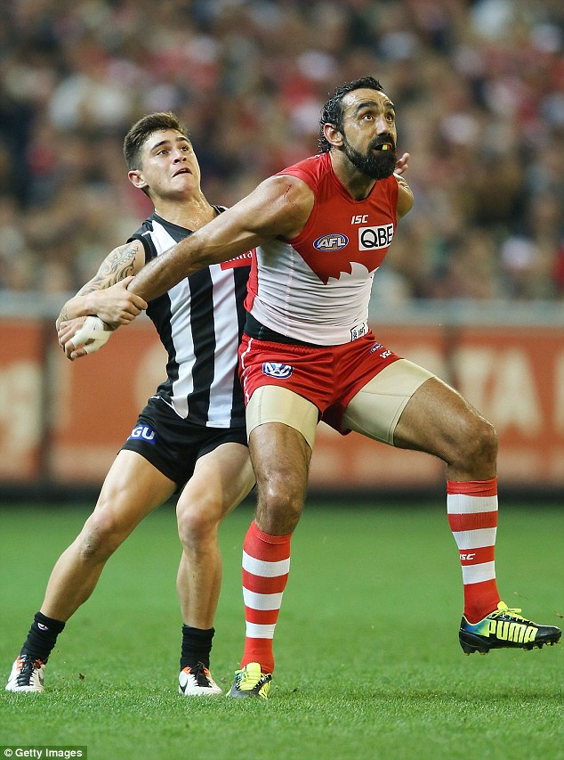 Challenge: Goodes (right) and Marley Williams of Collingwood battle for the ball