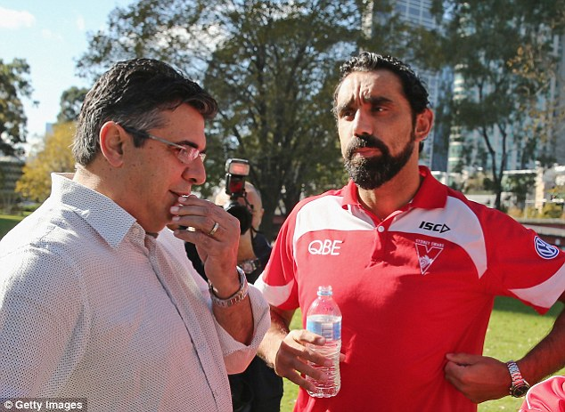 Aftermath: Adam Goodes (right) of the Sydney Swans speaks with AFL CEO Andrew Demetriou