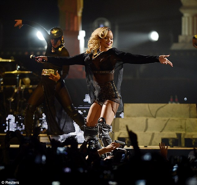 Much to celebrate: Rihanna beamed as she performed to a packed crowd on the opening night of the European leg of her Diamonds world tour at the Bilbao Exhibition Centre in Spain on Sunday