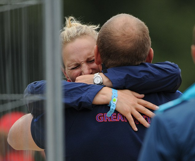 Support: Ms Phillips gets a hug from her husband after the equestrian show-jumping stage at the London Olympics