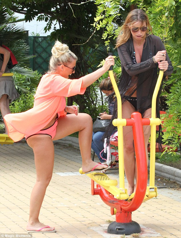 Jump on: The girls were having fun on the exercise apparatus, but didn't work up a sweat