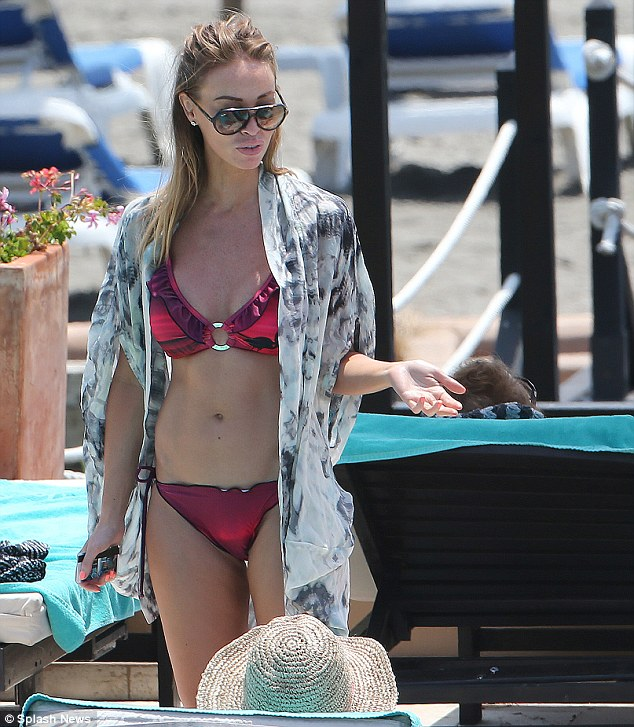 Super shape: Lauren Pope looked classy in her red bikini and Ray Ban sunglasses