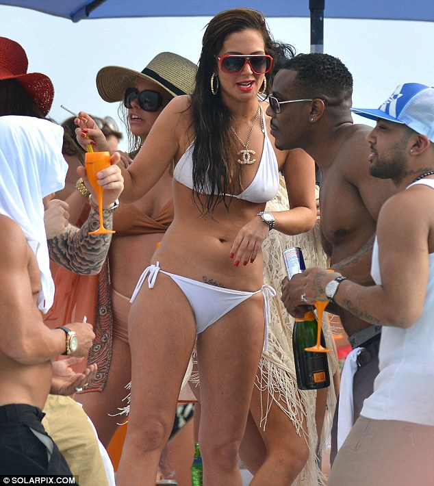 The secret's out! Tulisa was seen showing off her 'hidden' tattoo as she partied in a bikini in Marbella over the weekend