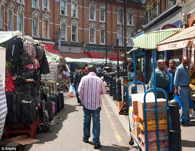 Changing: Paul Markey, an estate agent for Haart in the gentrifying neighbourhood of Brixton (pictured), south London, said it was 'boom time' and he had seen prices rise by 25 per cent there in one year