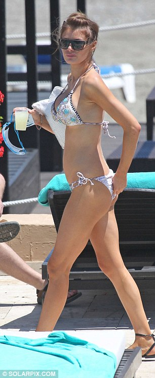 Bikini body: Despite her night of partying Chloe looked well rested as she strutted around the pool in her embellished bikini