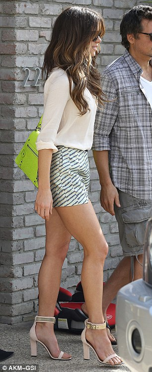 Sexy stems: The English actress showed off her toned legs in a pair of short shorts and ankle-strap heels
