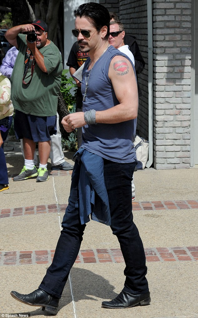 Gun show: Colin Farrell showed off his muscular arms on Monday while attending the annual Memorial Day party hosted by Hollywood producer Joel Silver at his Malibu home